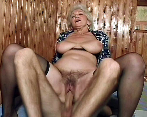Hot granny Erin shows off her tits and lures a younger guy into fucking her insatiable cunt