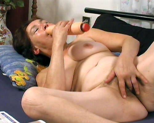 Horny granny Mitzi indulges her pussy with a good dose of dildo and cock drilling